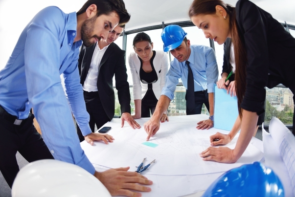 business people group on meeting and presentation  in bright modern office with construction enginee